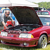 Dr. Richard Meadows of Beckley shows off his 1989 Ford Mustang GT at the Friends of Charity Auto Fair.<br /> Tina Laney/for The Register-Herald