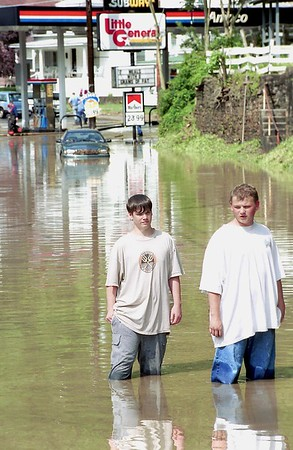 Matthew Richardson, left, and Mike Goode, both from Mullens  walk down Guyandotte Ave. in Mullens<br /> Barbero Photo