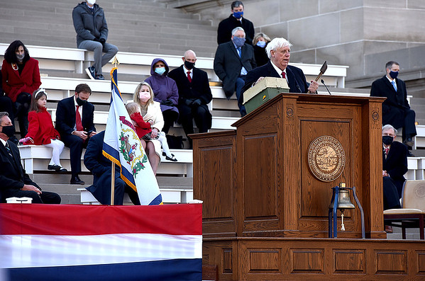 After taking the oath of office at the West Virginia Capitol Friday, Governor Jim Justice holds the same tackle box and hatchet he held up during his last inauguration in 2017.  Justice saw a desparate woman with her daughter next to the road selling anything she could to try to get by.  To help out he gave her $200 for the two items that he still keeps with him as a reminder.  (Craig Cunningham/The Register-Herald)