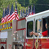 Engine 13 from Brenton in the Pineville Labor Day parade.<br /> Jim Cook/for the Register-Herald
