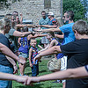 F. Brian Ferguson/Register-Herald  Participants in the balloon toss measure off their throwing distance on the Fayette County Courthouse lawn during Saturday's Independence Day events in Fayetteville.