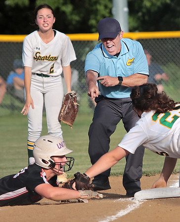 St. Albans Sydney Young is tagged out on third by Greenbrier East's Lindsey Black during the Class AAA Region 3 softball game against St. Albans in Fairlea Monday.  Jenny Harnish for the Register-Herald