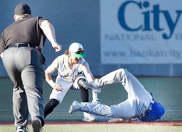 Short Stop for the WV Miners Jake Reifsnyder tags out Alex Ryan for the Champion City Kings while trying to steal 2nd base making it 2 outs.<br /> Tina Laney/for The Register-Herald