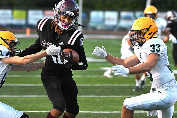 Elijah Redferm, of Woodrow Wilson, gets brought down by, Levi Wagner, of Greenbrier East, left, and Jarrett McHale, during game held at VanMeter Stadium in Beckley Friday night.<br /> (Rick Barbero/The Register-Herald)