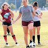 Woodrow Wilson girls soccer coach Julie Agner talks to her team during practice Tuesday at the YMCA Paul Cline Memorial Youth Sports Complex. Jenny Harnish/The Register-Herald