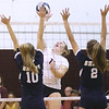 (Brad Davis/For The Register-Herald) Woodrow Wilson's Saira Diehl attacks as Shady Spring's Braylie Wiseman left, and Kelsie Dangerfield try to block during Shirley Brown Invitational action Saturday morning in Beckley.