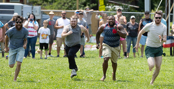 Kids of all ages participating in the field events at the Alderson 4th of July field events.<br /> Tina Laney/for The Register-Herald