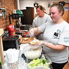Tabbitha Mains, owner, left, and Harley Young, preparing lunch for customers at Coffee On Main on Main Street in Beckley.<br /> (Rick Barbero/The Register-Herald)