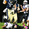 Cole Vandall, 2, of Greenbrier West, goes airborne for some yardage against James Monroe during first half action Friday evening at Greenbrier West High School.<br /> (Rick Barbero/The Register-Herlad)