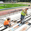 Keith Cyrus, left, and Tim Adkins, with PCM Contractor, are adding handrails, wheelchair ramp and seating for handicap on the home side at Shady Spring High School football field. Raleigh County Schools Superintendent David Price said, the field and home bleachers will be finished for the home openering this Friday against Tug Valley and the visitor bleacher will not be completed by kickoff, but will have designated seating for the opposing team.<br /> (Rick Barbero/The Register-Herald)