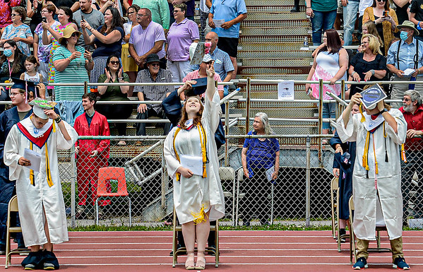 F. Brian Ferguson/Register-Herald  The Independence Class of 2021 toss their hats at the end of Sayurday's graduation at the football field in Coal City.