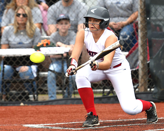 Malayia Campbell, of Midland Trail, lays down a bunt against Ritchie County during the Class A State Softball Tournament held at Little Creek Park in South Charleston.<br /> (Rick Barbero/The Register-Herald)