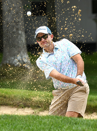 Aaron Kemlock hits from the trap on the par 3, 7th hole during the final round of the Mountain State Golf Classic held on the Cobb course Monday.<br /> (Rick Barbero/The Register-Herald)