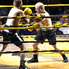 Joe Hunt on the left looses the match tonight against Marcus Mcguire during The Toughman Contest Saturday night.<br /> Tina Laney/for The Register-Herald