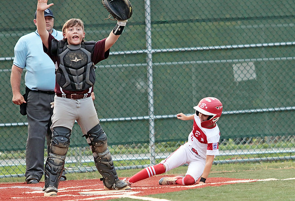 Beckley's Gage Price reacts while Barbourville's Hunter Workman slides into home during the State Little League game Tuesday in Lewisburg. Jenny Harnish/The Register-Herald