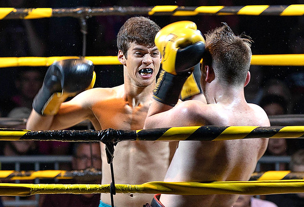 Trevor Bell in the blue shorts takes the win tonight against River Simms during the Toughman Contest. <br /> Tina Laney/for The Register-Herald