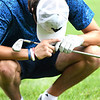 Todd Duncan drops his head after flying the green on the par 4, 16th hole during the final round of the Mountain State Golf Classic held on the Cobb course Monday.<br /> (Rick Barbero/The Register-Herald)