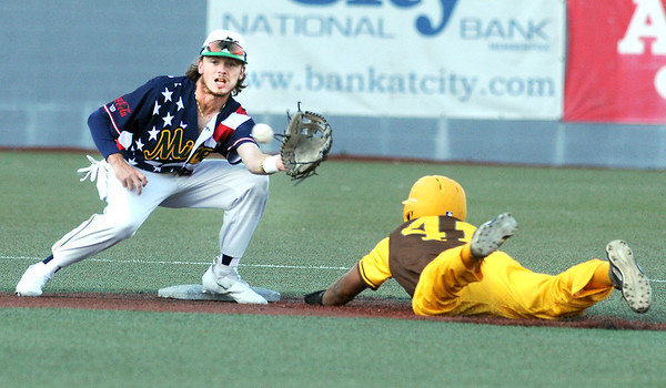 Miners shortstop Jake Reifsnyder takes the throw from the catcher as Millrats Trey Lipscomb steals second base. Jon C. Hancock/for the Register-Herald