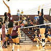 ZaMahya Moss for Woodrow Wilson High School with a battle at the net against Kyra Davis for Independence High School. <br /> Tina Laney/for The Register-Herald