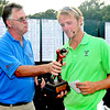 David Hunter left presents the winner of the BNI Memorial Tournament Bosten Miller with the Championship trophy on Monday at Glade Springs. Chris Tilley/The Register-Herald