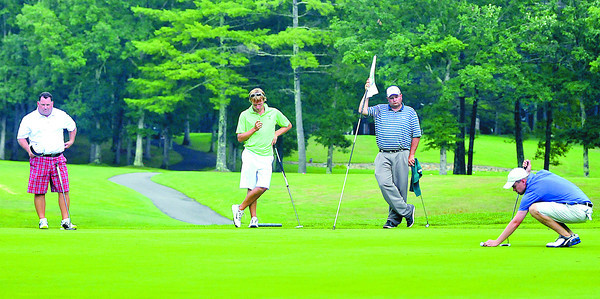 Left to Right Allen Wharton, Bosten Miller, Kelly Shumate, and Brandon Reece during the final round BNI Memorial Tournament on Monday at Glade Springs. Chris Tilley/The Register-Herald