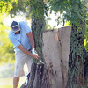 F. BRIAN FERGUSON/THE REGISTER-HERALD=Sean Lilly attempts to chip from around a tree on #9 during Saturday's opening round of the BNI at Grandview.