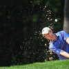 Brandon Reece hitting out of a sand trap during the final round BNI Memorial Tournament on Monday at Glade Springs. Chris Tilley/The Register-Herald