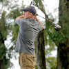 F. BRIAN FERGUSON/THE REGISTER-HERALD=Aaron Neal tees off on #1 during Saturday's opening round of the BNI at Grandview.
