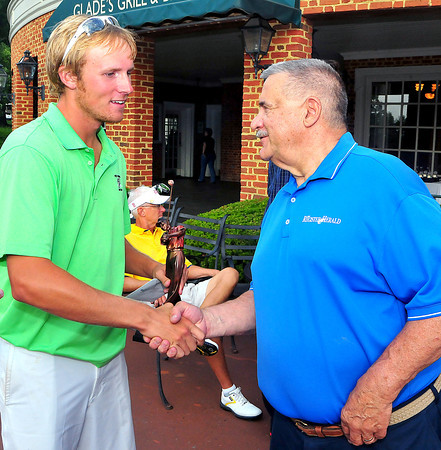 Bosten Miller, left winner of the BNI getting congratulated by Register-Herald publisher Frank Wood on Monday at Glade Springs. Chris Tilley/The Register-Herald