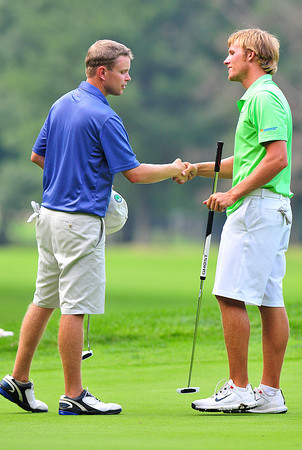 Brandon Reece left congratulating Bosten Miller after their playoff during the final round BNI Memorial Tournament on Monday at Glade Springs. Chris Tilley/The Register-Herald
