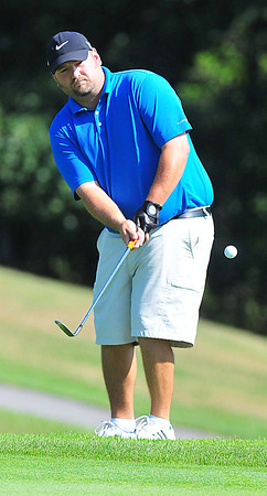 Greg Midkiff chips onto  the green during the BNI Memorial Tournament on Sunday at Pipestem. Chris Tilley/The Register-Herald