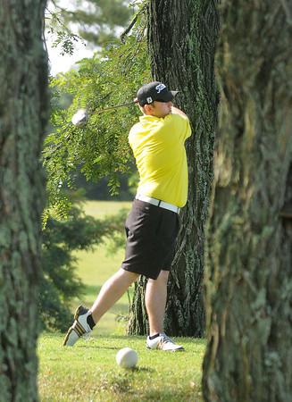F. BRIAN FERGUSON/THE REGISTER-HERALD=Nick Mays tees off on #1 during Saturday's opening round of the BNI at Grandview.