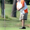 F. BRIAN FERGUSON/THE REGISTER-HERALD=Eric Scalk watches his putt un #9 during Saturday's opening round of the BNI at Grandview.