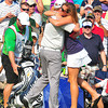 Ted Potter, Jr and his girlfriend Cheri Cox, embrace after Potter won The Greenbrier Classic on Sunday. Chris Tilley/The Register-Herald
