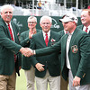 Jim Justice, Chairman and CEO of The Greenbrier Resort, left, shakes Ted Potter Jr hand after winning The Greenbrier Classic.<br /> Marcus Constantino/Charleston Daily Mail