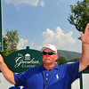 Larry Gray, a volunteer for The Greenbrier Classic help silence  the crowds on Sunday during the final round. Chris Tilley/The Register-Herald