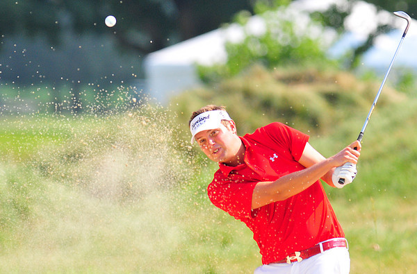 Jeff Overton hits from the bunker on 17 during the final round of The Greenbrier Classic on Sunday.  Chris Tilley/The Register-Herald