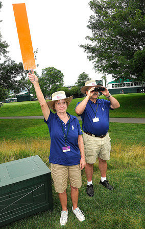Jeannie Felton, Basye Va., left, and Greg Peator, Akron Ohio, volunteers on the second hole during the first round of The Greenbrier Classic held on The Old White TCP course in White Sulphur Springs.<br /> Rick Barbero/The Register-Herald
