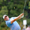 Scott Stallings hits his second shot on the 7th hole during the first round of The Greenbrier Classic held on The Old White TCP course in White Sulphur Springs.<br /> Rick Barbero/The Register-Herald