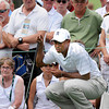 Tiger Woods studying his chip shot on the 8th hole during the first round of The Greenbrier Classic held on The Old White TCP course in White Sulphur Springs.<br /> Rick Barbero/The Register-Herald