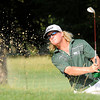 Charley Hoffman hits out of the trap on the 7th hole during the first round of The Greenbrier Classic held on The Old White TCP course in White Sulphur Springs.<br /> Rick Barbero/The Register-Herald