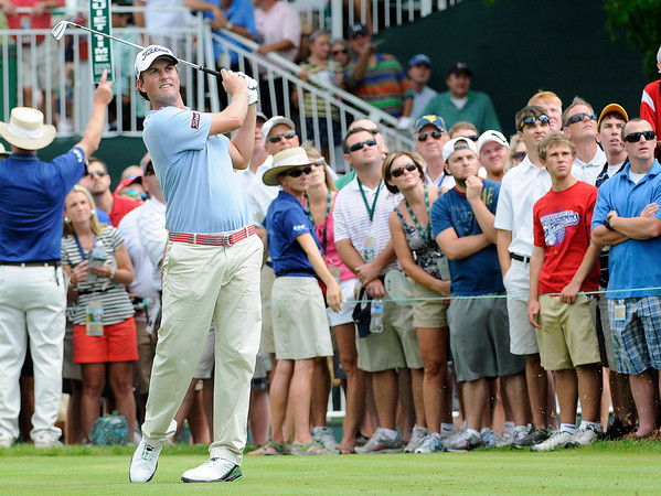Webb Simpson watching his tee shot on the 18th hole during the first round of The Greenbrier Classic held on The Old White TCP course in White Sulphur Springs.<br /> Rick Barbero/The Register-Herald