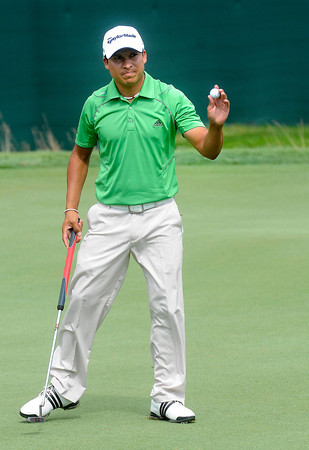 Andres Romero waves to the crowd after making a birdie on the 18th hole during the first round of The Greenbrier Classic held on The Old White TCP course in White Sulphur Springs.<br /> Rick Barbero/The Register-Herald