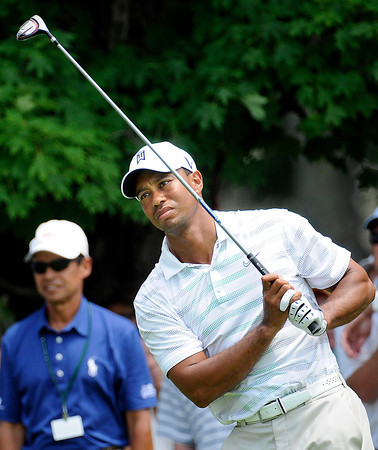 Tiger Woods watching his tee shot on the 9th hole during the first round of The Greenbrier Classic held on The Old White TCP course in White Sulphur Springs.<br /> Rick Barbero/The Register-Herald