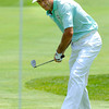 Stuart Appleby chips up on the first hole during the first round of The Greenbrier Classic held on The Old White TCP course in White Sulphur Springs.<br /> Rick Barbero/The Register-Herald