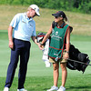 Steve Stricker getting a club from his wife Nicki on the 17th hole during the first round of The Greenbrier Classic held on The Old White TCP course in White Sulphur Springs.<br /> Rick Barbero/The Register-Herald