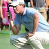 Webb Simpson lines up his putt on the third hole during the first round of The Greenbrier Classic held on The Old White TCP course in White Sulphur Springs.<br /> Rick Barbero/The Register-Herald