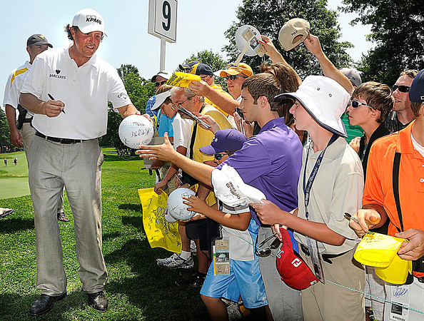 Phil Mickelson, left, signing autographs during The Greenbrier Classic Pro-Am held on The Old White TPC course.<br /> Rick Barbero/The Register-Herald