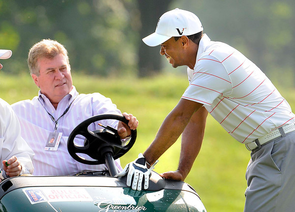 Tiger Woods, right, talks with Slugger White, VP of rules and competitions for PGA Tour, during The Greenbrier Classic Pro-Am held on The Old White TPC course.<br /> Rick Barbero/The Register-Herald