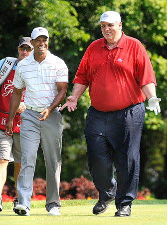 Tiger Woods, left, walks down the 12th fairway with Jim Justice, during The Greenbrier Classic Pro-Am held on The Old White TPC course.<br /> Rick Barbero/The Register-Herald